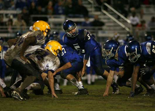 Bryant quarterback Hayden Lessenberry (5) prepares to take a snap from Blain Jackson. (Photo by Rick Nation)