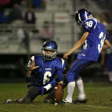 Josh Lowery (38) kicks an extra point out of the hold of Austin Powell (6). (Photo by Rick Nation)