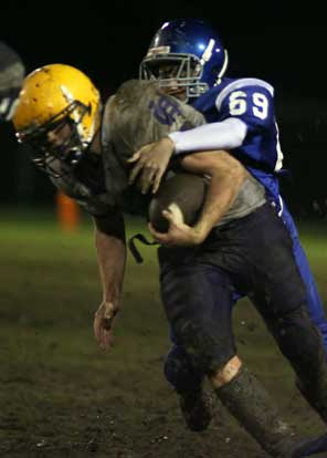 Chris Stringer makes a tackle from behind Catholic's Cole Boardman. (Photo by Rick Nation)
