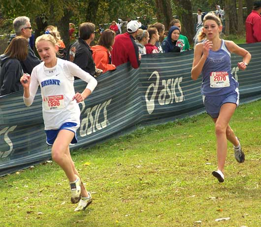 Bryant freshman Hannah Raney, left, out-kicks a rival during her school-record run at the prestigious Chile Pepper Invitational in Fayetteville Saturday.