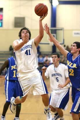 Zach Cambron puts up a shot after driving into the lane. (Photo by Rick Nation)