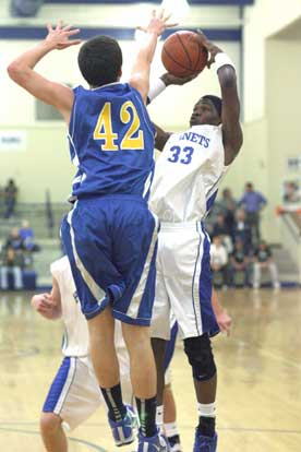 Bryant's Leon Neale (33) shoots over North Little Rock's Matt Terry. (Photo by Rick Nation)