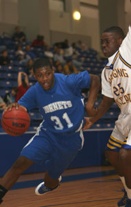 Bryant's Dijon Benton, 31, drives around North Little Rock's Chris Campbell.