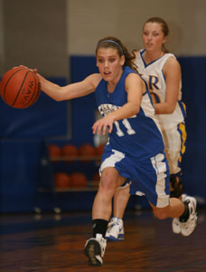 Bryant's Haley Montgomery pushed the ball up the floor against the North Little Rock press.