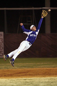 Second baseman Hunter Alford leaps high to try to spear a liner to right.