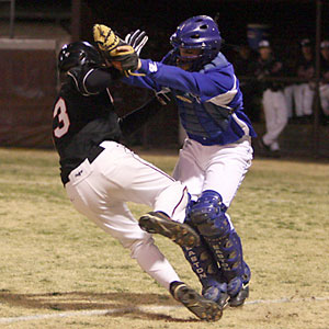 Bryant catcher Brady Butler tags out Searcy's Preston Tarkington after he had been picked off third.