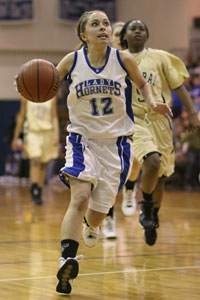 Taylor Hughes drives to the basket.