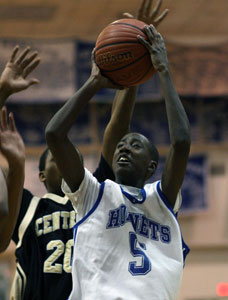 K-Ron Lairy goes up for a shot in front of Little Rock Central's Andre Dennis.