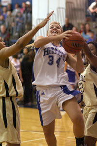 Anna Simpson drives past Little Rock Central's Adre Ann Walker, left, and Shawnsee Arnold.