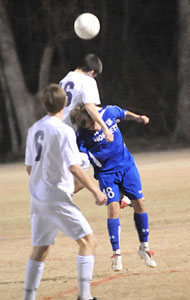 Peter Alverio and a Little Rock Catholic player both try to get their head on the ball.