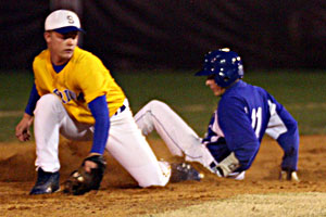 Bryant's Garrett Bock, 11, slides into second with a stolen base as Sheridan second baseman Zach Perkins reaches for the throw.