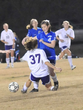Allison Woodward battles for possession with a Mount St. Mary's player.