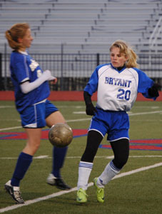 Lauren Reed, 20, maneuvers past a Mountain Home defender.