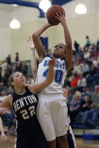Bryant's Brea Blundell shoots over Benton's Mallory Carver.