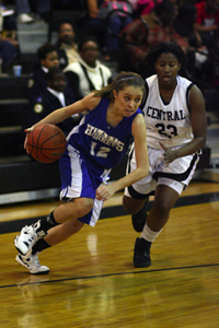 Bryant Lady Hornets point guard Taylor Hughes drives around Central's Shawnsee Arnold.