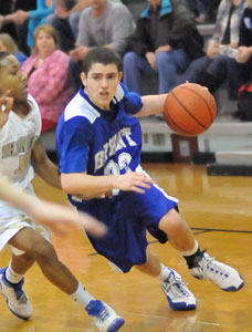 Cody McPherson drives around Sheridan's Jaylynn Elliott during Monday's Central Arkansas Junior High Conference tournament game.
