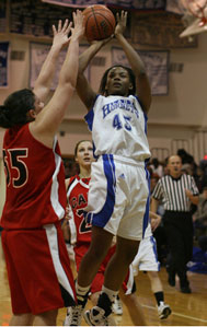 Bryant's Alana Morris (45) shoots over Cabot's Stephanie Glover.