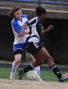 Erica Selig, left, battles for possession during a game against Little Rock Central last season.