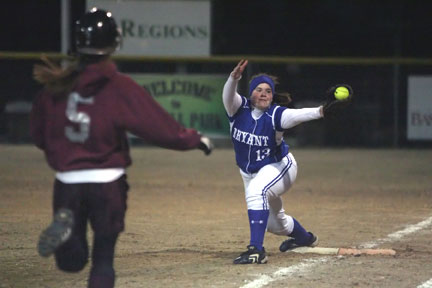 Bryant's Brandi Barnes stretches to grab a throw at first base.