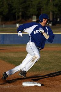 Garrett Bock rounds third on his way to a first-inning run.