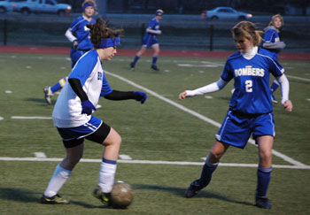 Bryant's Erica Selig, left, works to get around a Mountain Home defender.