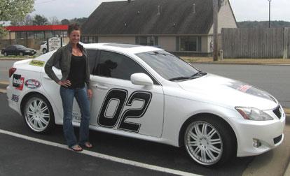 Brooke Bettoney and her decal-laden Lexus star in SpeedTV's Bullrun.
