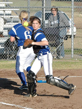 Catcher Sarah Hart makes a play on a bunt during Monday's game at Russellville.