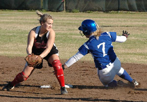 Senior Christen Kirchner (7) slides wide to avoid a play at second on a stolen base.