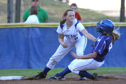 Bryant's Jessie Taylor applies a tag at third.