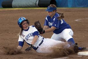 Conway third baseman Mandy Eggert tags out Bryant's Kayla Sory as she slides in after trying to tag and advance from second on a fly to right during the fourth inning of Tuesday's game.