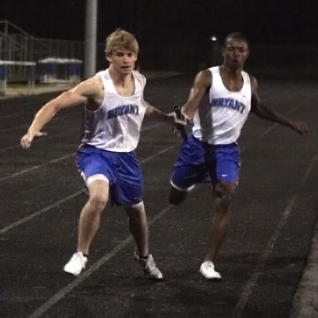 Bryant's Tyler Freshour takes the baton from teammate James Glasper during the 400 meter relay Thursday. (Photo by Rick Nation)