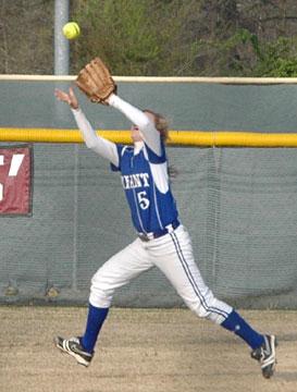 Jenna Bruick hauls in a flyball. (Photo by Mark Hart)