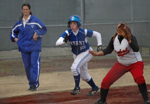Bryant coach Lisa Stanfield looks on as Kayla Sory makes a break off third. (Photo by Mark Hart)