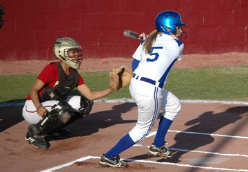 Jenna Bruick moves toward a pitch, for a slap at the ball. (Photo by Mark Hart)