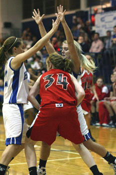 Taylor Hughes, left, and Anna Simpson trap a Russellville player during a game earlier this season.