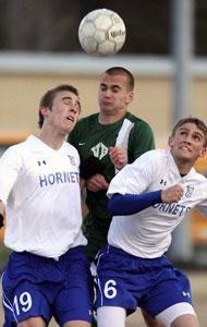 Tyler Salminen, 19, and Aaron Prewitt, 6, battle head-to-head-to-head with a Van Buren player for control.