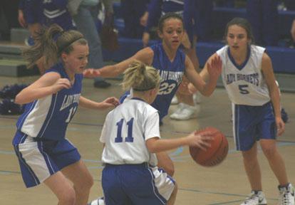 Logan Davis, left, and McKenzie Adams apply defensive pressure against Bethel's Megan Archibald, 11, and Carley Staggs, 5.