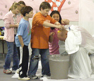 Salem Elementary Principal Mark Scarlett gets an egg shampoo from the students during the Jump Rope for Heart Assembly.