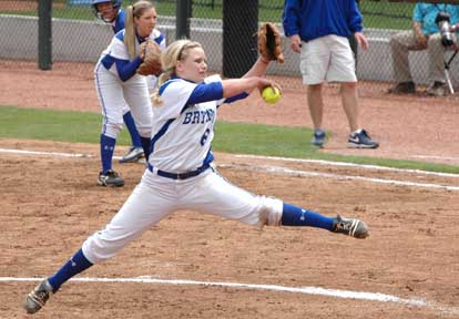Pitcher Peyton Jenkins cranks up for a delivery while Kayla Sory sets up defensively at first. (Photo by Mark Hart)