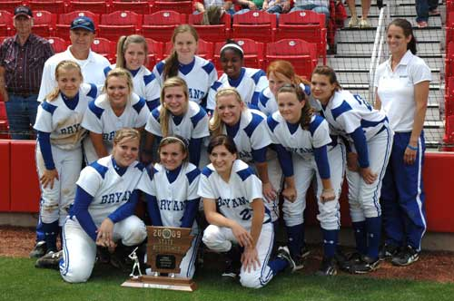 Head coach Lisa Stanfield, back right, and assistant Chris Kirchner join in the Lady Hornets team picture with their State runner-up trophy after Saturday's game at Bogle Park in Fayetteville. (Photo by Mark Hart)