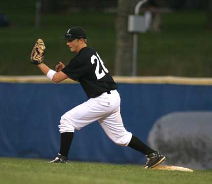 Brady Butler stretches for a throw to first. (Photo by Rick Nation)