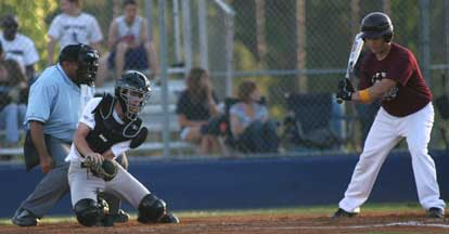 Bryant catcher B.J. Ellis snags a pitch in the dirt during Tuesday's game. (Photo by Rick Nation)