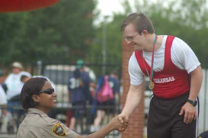 Joshua Garland is congratulated after receiving one his gold medals at the Special Olympics.