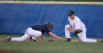 Brady Butler takes a pickoff throw to first as the Pine Bluff baserunner dives back to the bag. (Photo by Rick Nation)