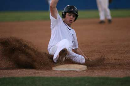 Tyler Sawyer slides into third to complete his first-inning RBI triple. (Photo by Rick Nation)