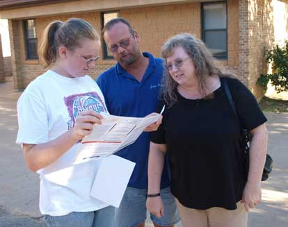 A freshman student and her parents study a map of the Bryant High School campus. (Photo by Lana Clifton)