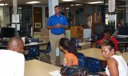 Principal Randy Rutherford talks with the parents of incoming frehshmen at the Back To School Bash. (Photo by Lana Clifton)