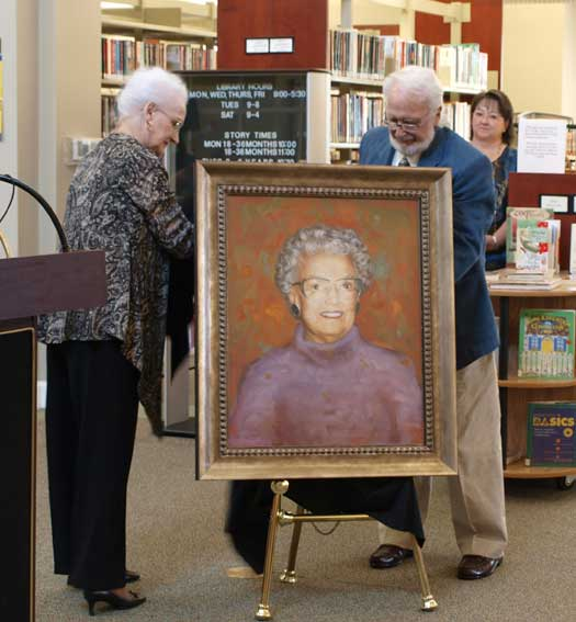 Valine Meyer and Ted Boswell unveil the portrait of their mother Mabel Boswell. (Photo by Lana Clifton)