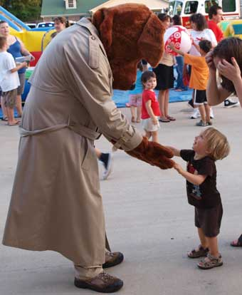 18-month old Seth Pope meets McGruff the Crime Dog. (Photo by Lana Clifton)