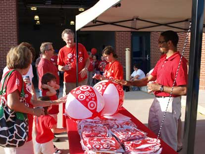 Target volunteers, Jessica Alvarado and Jason Deslandes help distribute beach balls. (Photo by Lana Clifton)